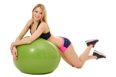 Sexy blonde laying on green fitness ball Stock Photos
