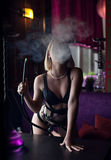 Sexy blonde in lingerie smoking a hookah Stock Images