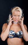 Sexy blonde listening music. Image of cute blonde at party Stock Images