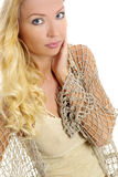 Blonde with long hair. Fashion shot over grey background royalty free stock photo