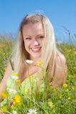 blonde on meadow with camomile stock images
