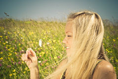 blonde on meadow with camomile stock image