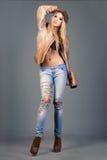 Sexy blonde Modefrau mit den langen Beinen Stockfotos
