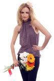 Sexy blonde model with a flower bouquet Stock Images