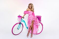 Free Sexy Blonde Model In Amazing Dress On Colorful Bike, Decorated With Flowers. Spring Concept. Beautiful Natural Woman In Elegant Royalty Free Stock Images - 221484029