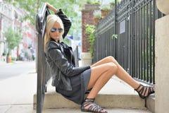 Sexy blonde model poses on concrete steps - urban fashion Stock Photos