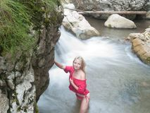Sexy blonde near waterfall Royalty Free Stock Images