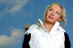 Sexy blonde over sky Royalty Free Stock Image