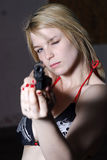 Woman pointing gun  Stock Images