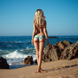 Sexy blonde on sea Stock Photos