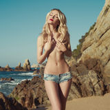 Sexy blonde at the sea Royalty Free Stock Photos