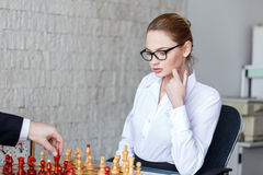 Sexy blonde secretary playing chess with boss Stock Images