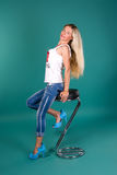 Sexy blonde sitting on a bar stool Royalty Free Stock Photography