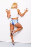 Sexy blonde sportliche Frau Stockbild