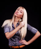 Sexy blonde staring. Image of cute  blond woman  wearing a shirt Royalty Free Stock Photography