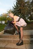 Blonde in stockings. With a big black bag royalty free stock photos