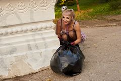 Blonde in stockings. With a big black bag royalty free stock photography
