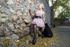 Blonde in stockings. With a big black bag stock photo