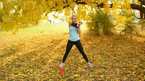 Woman exercising at the park stock footage