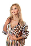 Sexy blonde in a striped men's shirt Stock Photography