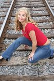 Blonde on the tracks. Posing Royalty Free Stock Images
