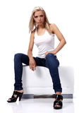 Sexy blonde wearing blue jeans Royalty Free Stock Photography