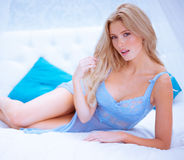 Sexy blonde woman on bed Stock Image