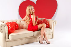 blonde woman with big heart. Royalty Free Stock Photos