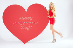 Sexy blonde woman with big heart. Stock Photography