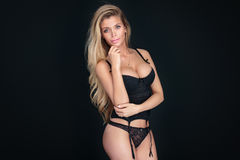Sexy blonde woman in black lingerie. Stock Photos