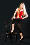 Sexy blonde woman with chair Stock Photography