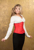 Sexy blonde woman in corset and skirt Royalty Free Stock Images