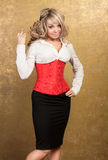 Sexy blonde woman in corset and skirt Stock Photos