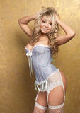 Sexy blonde woman in corset and white stocking Royalty Free Stock Photography