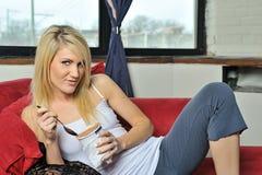 blonde woman eating ice cream Royalty Free Stock Photo