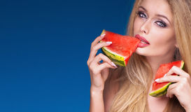 Sexy blonde woman eating watermelon. Royalty Free Stock Images