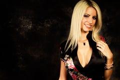 blonde woman fashion model in silk robe Stock Photos