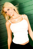 blonde woman fashion model in white tank top Stock Photo