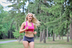 Sexy blonde woman fitness - outdoors Stock Photos