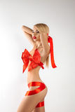 Sexy blonde woman-gift with ribbons on body looking away Stock Photo