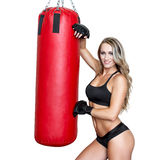 Sexy blonde woman with heavy bag Stock Images