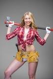 Sexy blonde woman holding an ax Stock Photos
