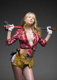 Sexy blonde woman holding an ax Royalty Free Stock Image