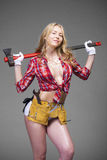 Sexy blonde woman holding an ax Royalty Free Stock Images