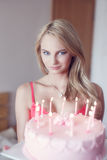 Sexy blonde woman holding birthday cake Stock Photo