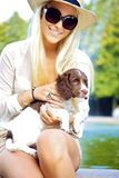 Sexy Blonde Woman Holding Dog Stock Photo