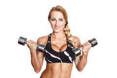 Sexy blonde woman holding dumbbells  Royalty Free Stock Images
