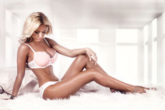 Sexy blonde woman in lingerie posing. Royalty Free Stock Images