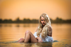 Sexy blonde woman in lingerie in a river water Stock Photos