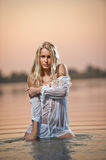 Sexy blonde woman in lingerie in a river water Royalty Free Stock Image